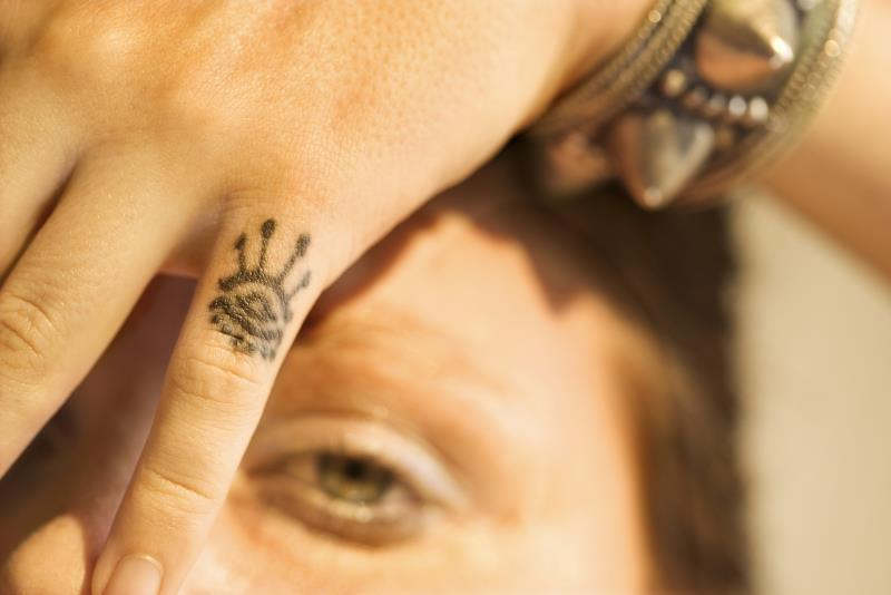 arabic tatto design in small finger