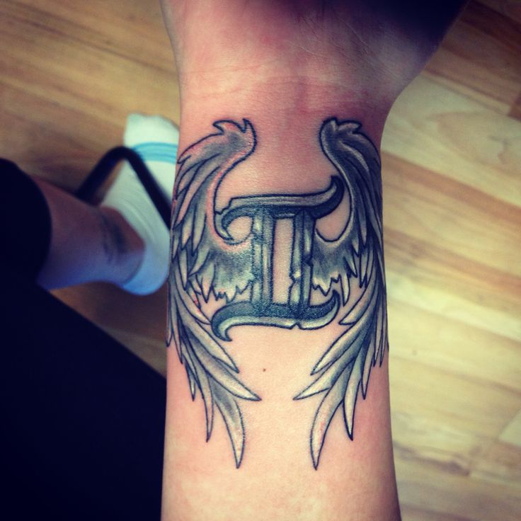 gemini tattoo with wings in wrist