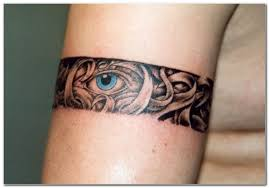 eye on arm band maori tattoo